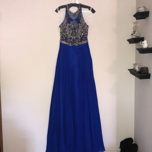 Floor-length, royal blue prom dress with gemstones